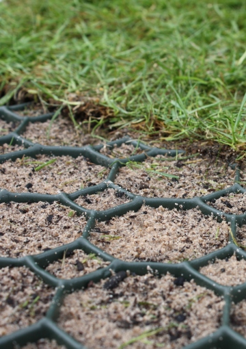 Permeable grass or gravel reinforced with plastic porous paving grids from Ultimate One Limited